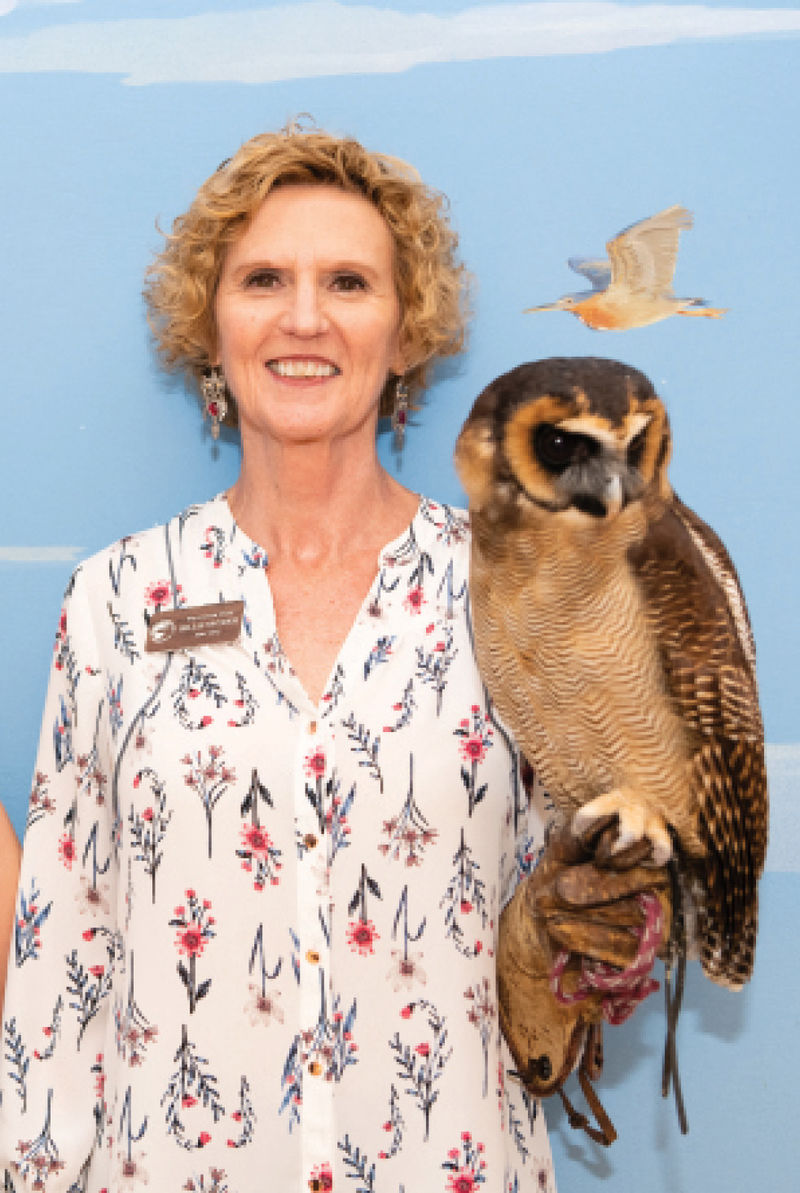 Volunteer staff member Billie Snyder and an Asian brown wood owl