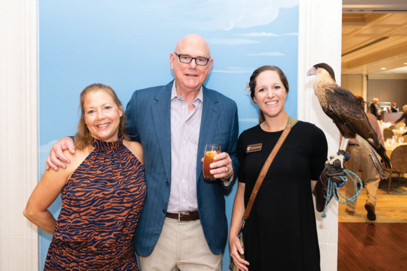 John and Kaye Nance with educator Natalie Hendrickson and a crested caracara