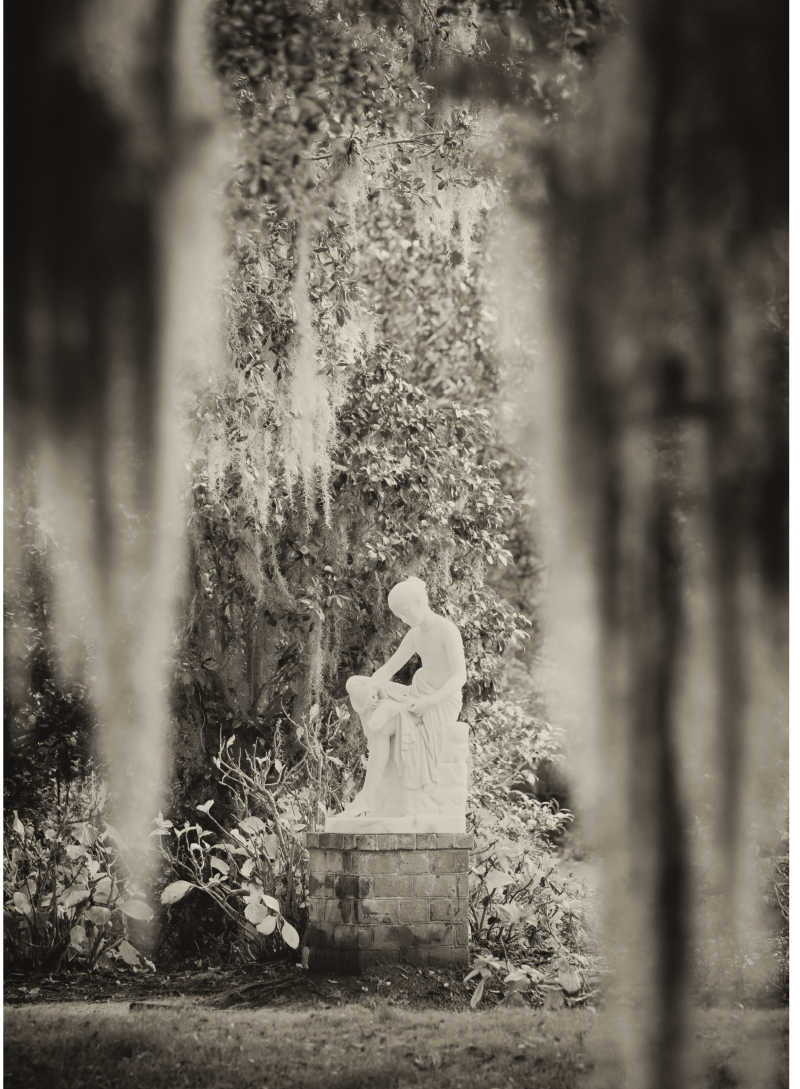 The Wood Nymph statue resting beneath festoons of Spanish moss at Middleton Place.
