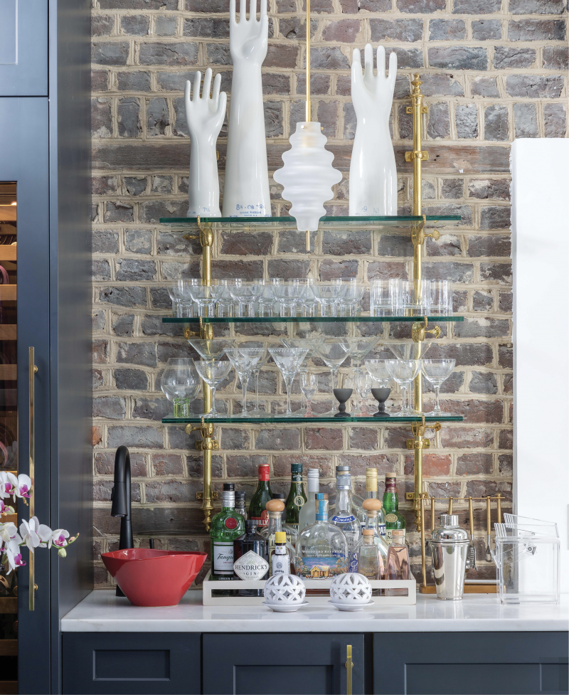 """High Touch - Vintage porcelain glove molds provide personality to this space, a """"hyphen"""" connecting the single house to its guest suite, which was transformed into a chic entertaining space, complete with wet bar.  Location: Ansonborough (owned by Betsy and Bruce Finley)  Issue: February 2020, """"A Twist  on Tradition""""  Photographer: Julia Lynn"""