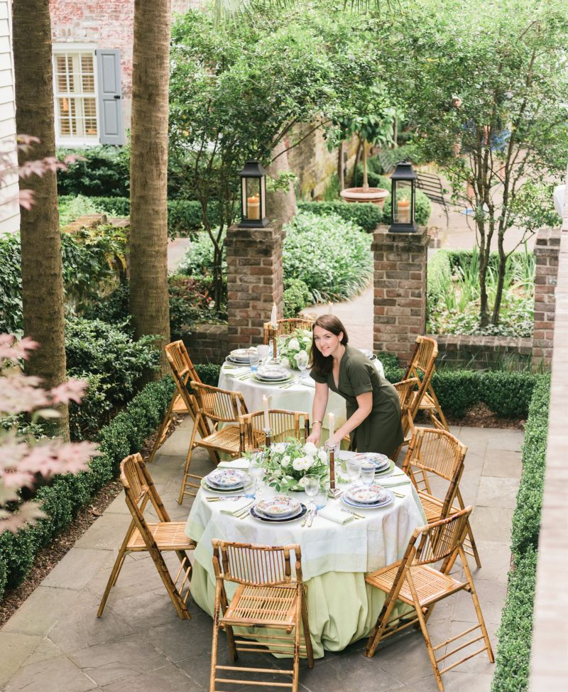 """Augusta Cole, Lynn's right hand at Easton Events, puts the finishing touches on the tables. """"I chose two rounds to break up the long, narrow space,"""" Lynn explains. """"I love creating intimate dinners, and nothing does that better than a 48-inch table."""""""