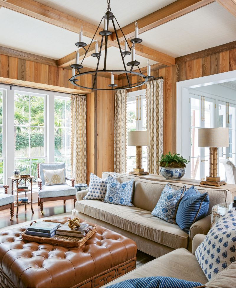 While updating a century-old residence South of Broad, architect Beau Clowney sought to reinstate some of the home's likely architectural past, such as the cypress paneling in this handsome den.