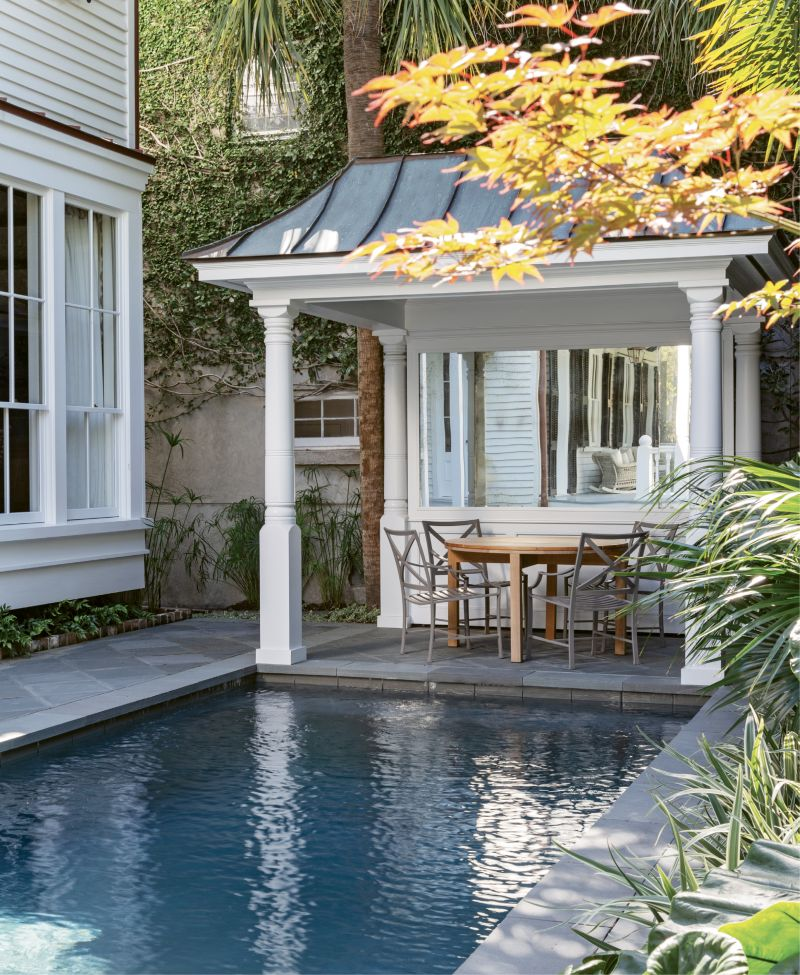 IN THE SWIM: A pool was on the must-have list for the couple, who wanted a spot their children and grandchildren would flock to. The sun-dappled patio provides the perfect perch for relaxing and watching them play.