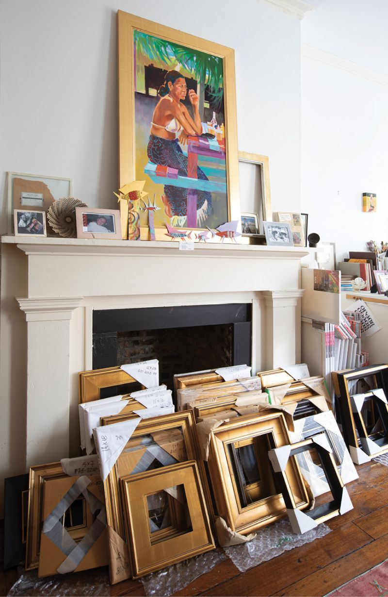 Paintings, both finished and in process, abound; gold frames stacked by the stately fireplace lie ready, waiting.