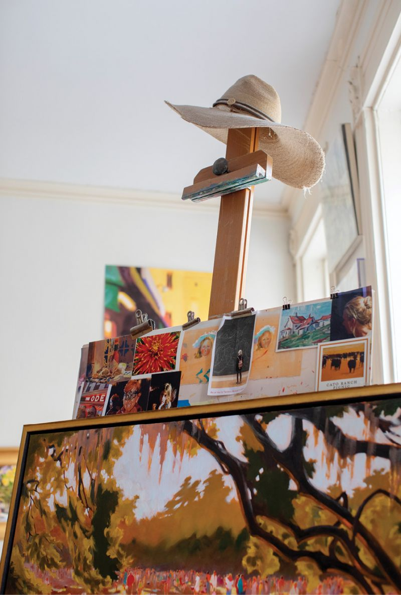 Her easel, bequeathed to her by a former art professor and mentor at Queen's University of Charlotte, is wreathed by an ad-hoc mood board of sorts—photos, studies, and sentimental images.