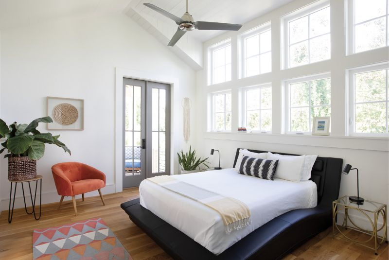 """Early To Rise: With a """"less is more"""" decorating style, Erin kept her master bedroom free of window treatments—plus it helps them to wake early on weekdays, she says."""