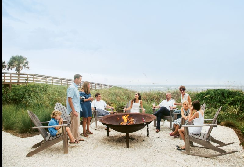 The family uses the fire pit, a 60-inch replica of a syrup kettle with a retrofitted grill, most Saturday nights to cook steaks and oysters.