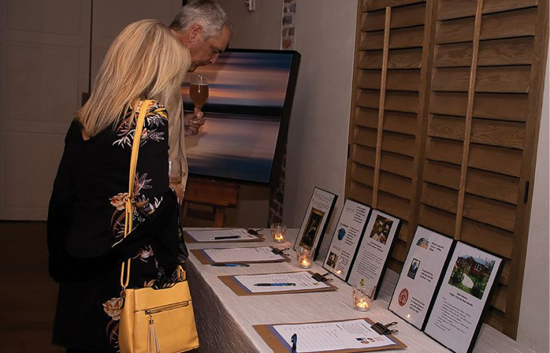 Guests bid on items in the silent auction, including tickets to local events, certificates to fine dining restaurants, and handmade goods and artwork.