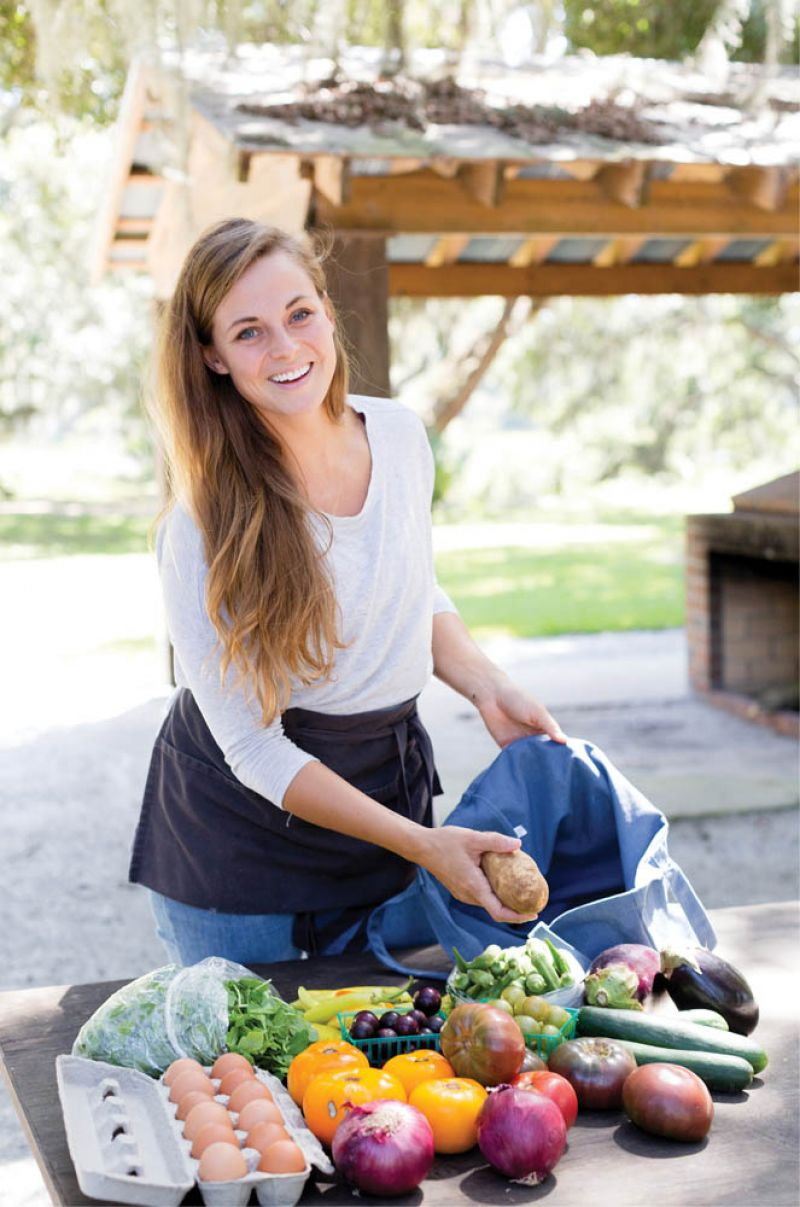 To Market: Candice Broyles manages the neighborhood's CSA program, for which property owners and other local neighbors can pay for seasonal or weekly shares. Bags full of freshly harvested produce and eggs are delivered every Wednesday