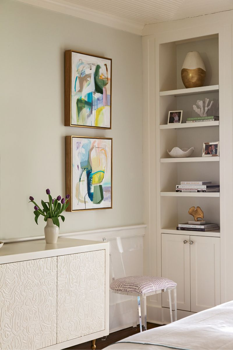 A hand-carved credenza by Kelly Wearstler is flanked with locally commissioned abstract paintings by Emily Brown.