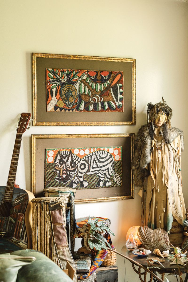 In Comer's living room, beaded art from Africa hangs next to a Native American protector warrior doll for which she bartered a coat she batiked with native symbols.