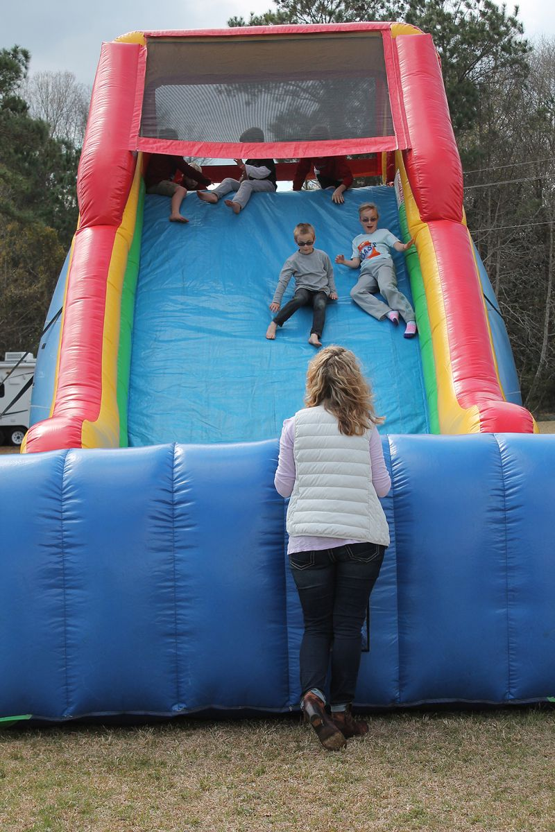 Kids slid down the fun-slide as parents watched