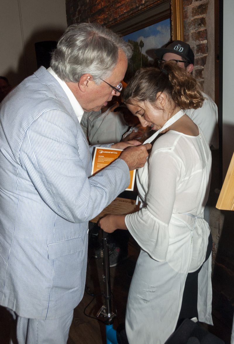 Mayor John Tecklenburg presents Little Chef Isabella Hurd with a pin; each Little Chef got one, making them honorary health ambassadors of Charleston.