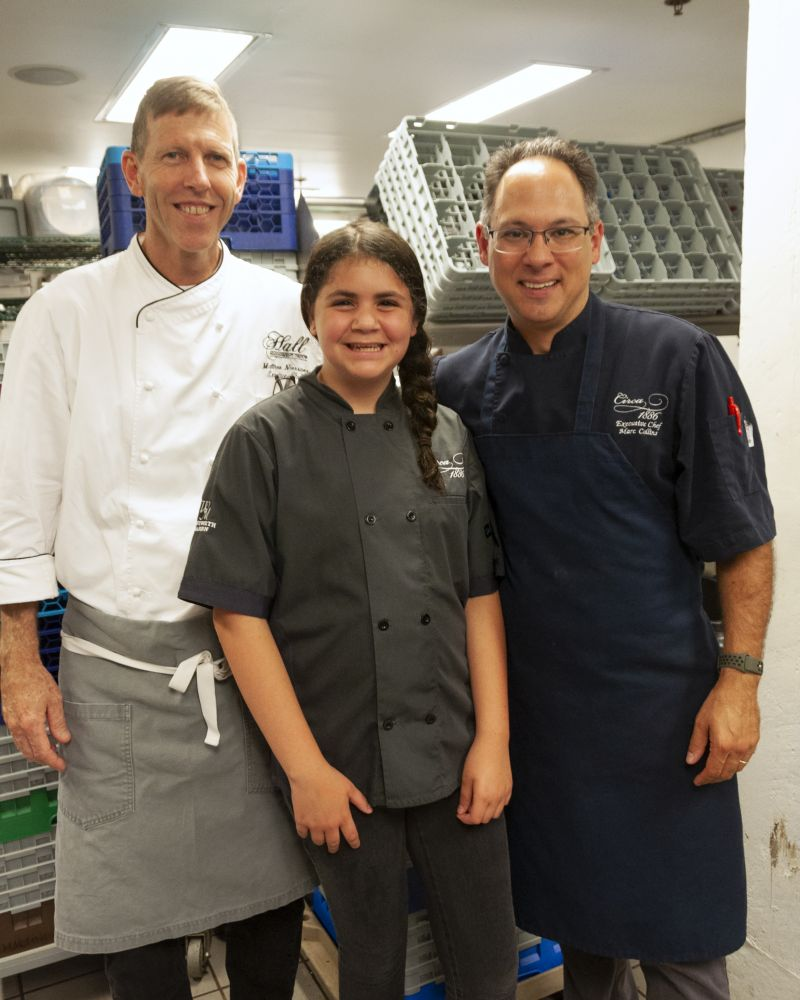 Head Chef Matthew Neissner of Halls Management Group, Little Chef Ella Bruno, and Big Chef Marc Collins of Circa 1886 in the kitchen.
