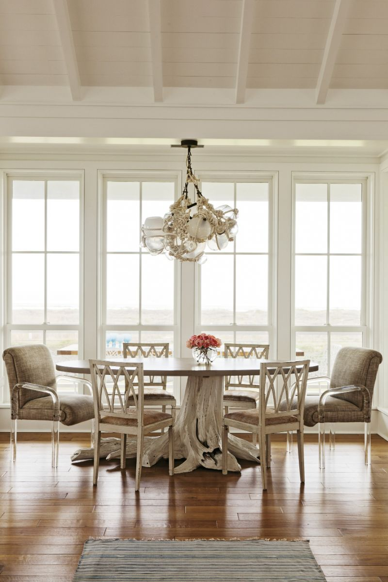 Furniture maker Brian Hall searched high and low for the perfect cypress stump to anchor the dining table.