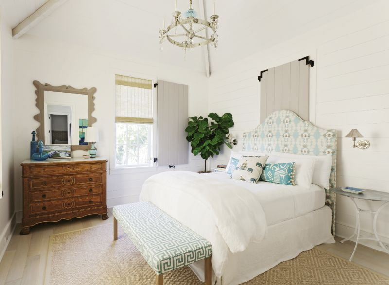 Beach Dreams: A guest bedroom, outfitted with dreamy creams and blues, proves that comfort and class can come in smaller sizes.