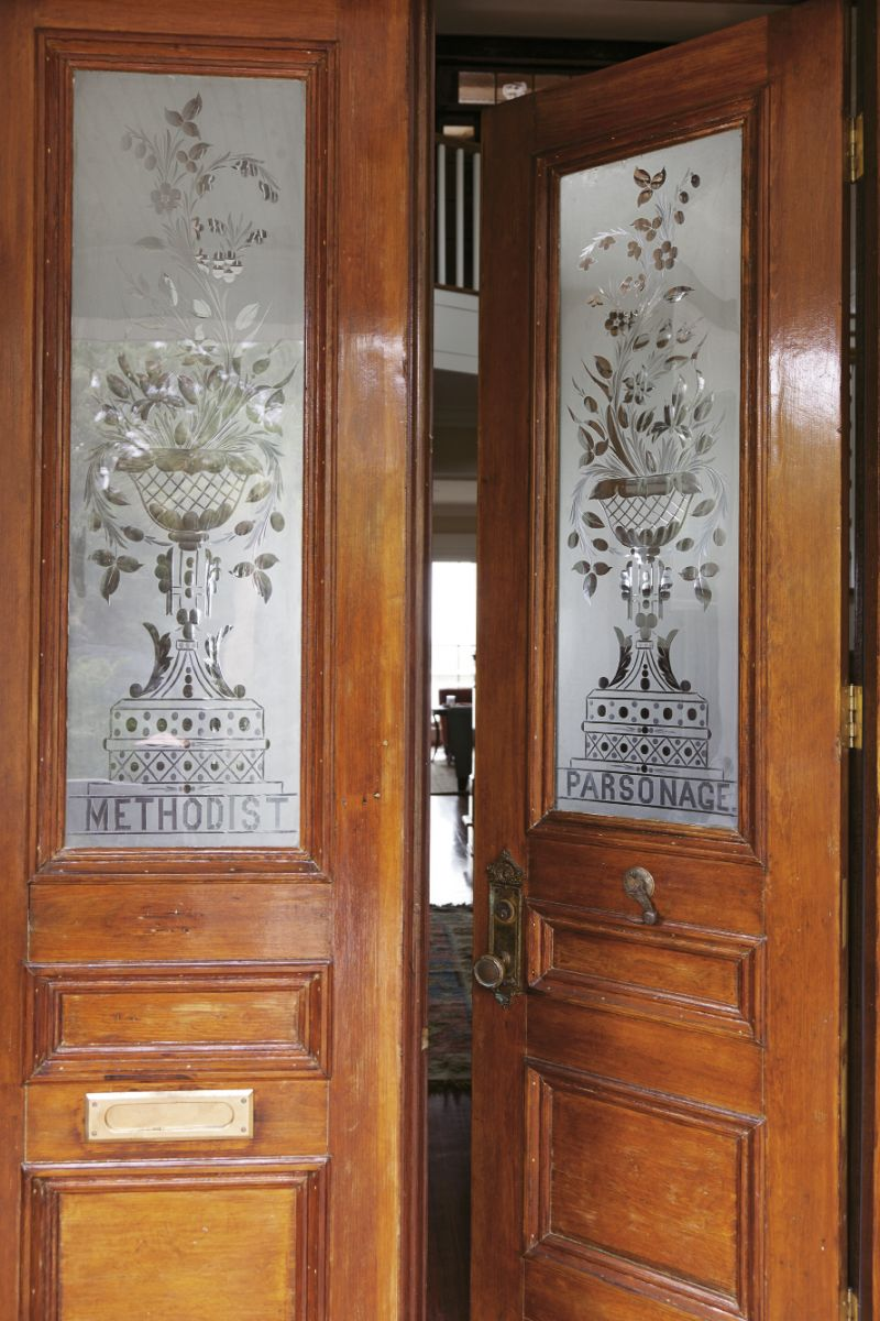 Salvaged doors from a Methodist parsonage were installed as front doors