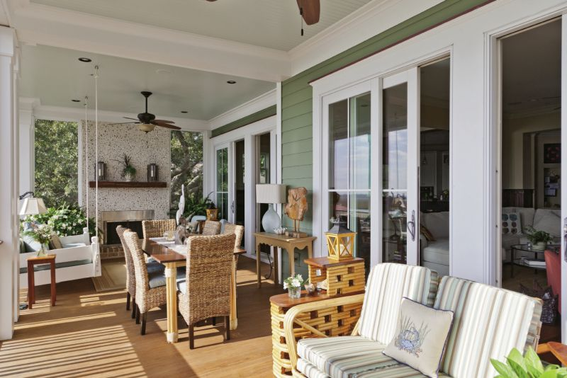 local builder Carl Derick crafted the couple's porch dining table, and the chairs were purchased from Steinmart.