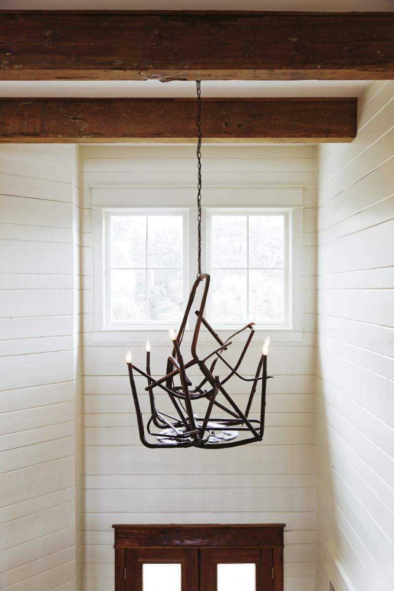 ; a College of Charleston art student crafted the metal from chairs melted in the Bowen's Island restaurant fire into a chandelier that hangs in the front foyer