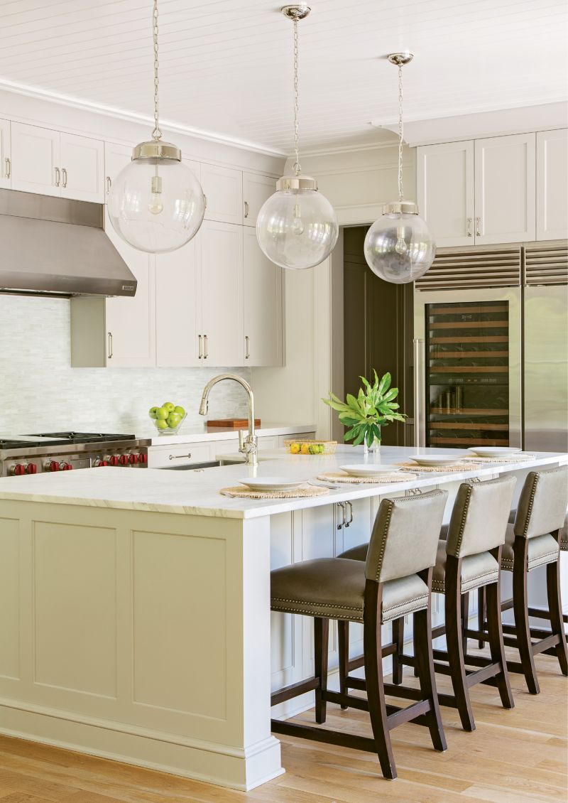 Island Living: The Calcutta gold marble island is the kitchen centerpiece and hub of family life, with kids coming and going from school and tennis practice and the two physicians coordinating busy schedules.