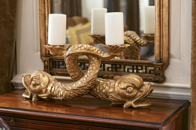 18th-century gilt dolphins found through G. Sergeant Antiques play nicely off the gold tones seen throughout.