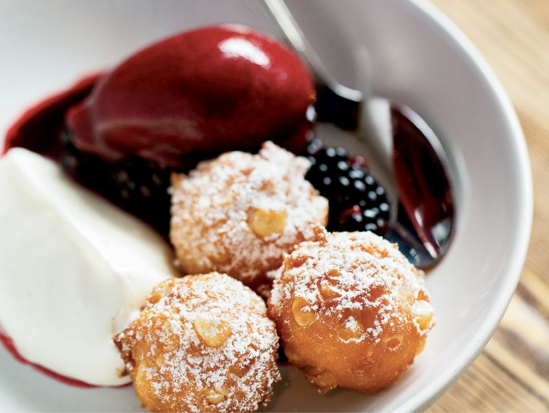 Decadent dish: Sweet corn fritters with blackberry coulis and whipped mascarpone