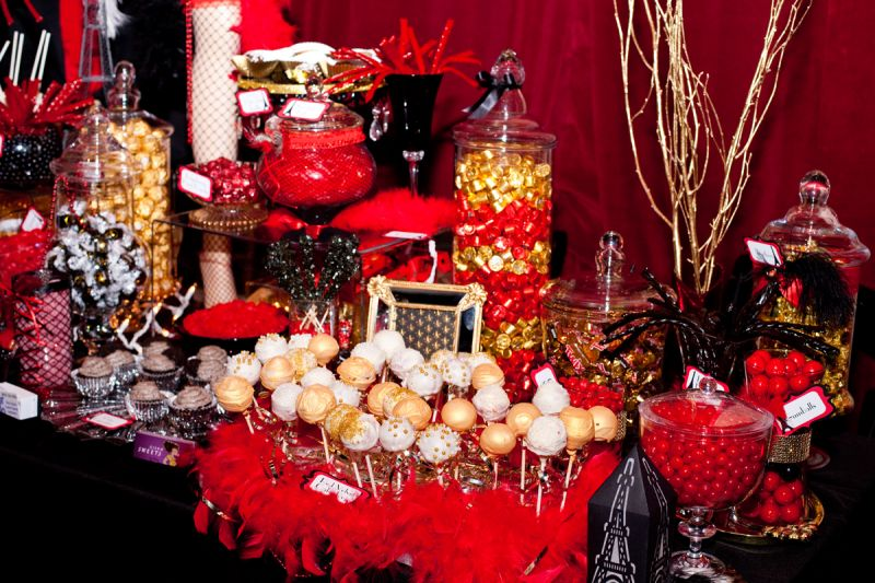 The candy table by Candy Catered featured cake pops by Kisam Sweets.