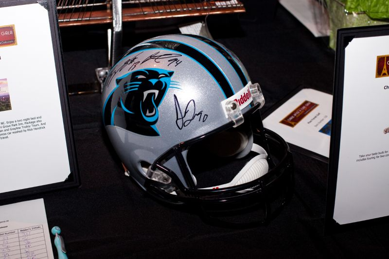 Attendees bid on an autographed Carolina Panthers helmet.