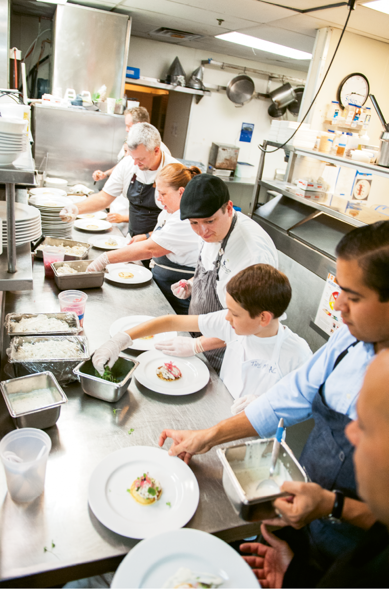 On the line (from left): Big Chefs Bacon, Weaver, and Kelly;  Little Chef Jacob Kestenbaum; and Big Chef Toscano