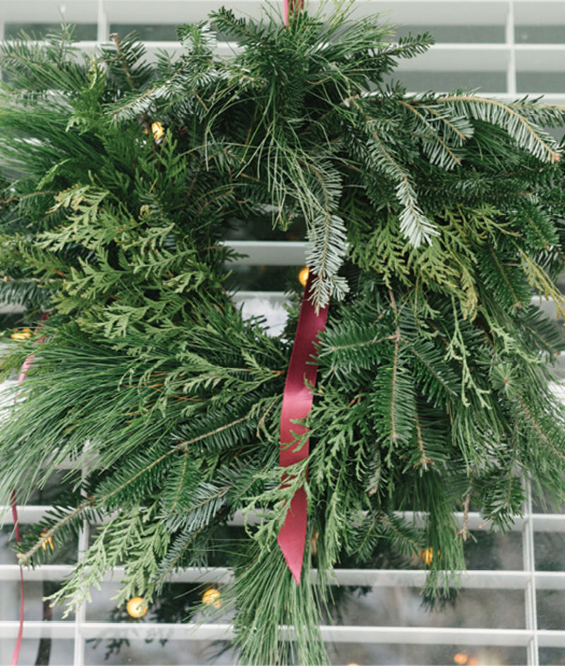 She also created three simple pine wreaths for the front windows.