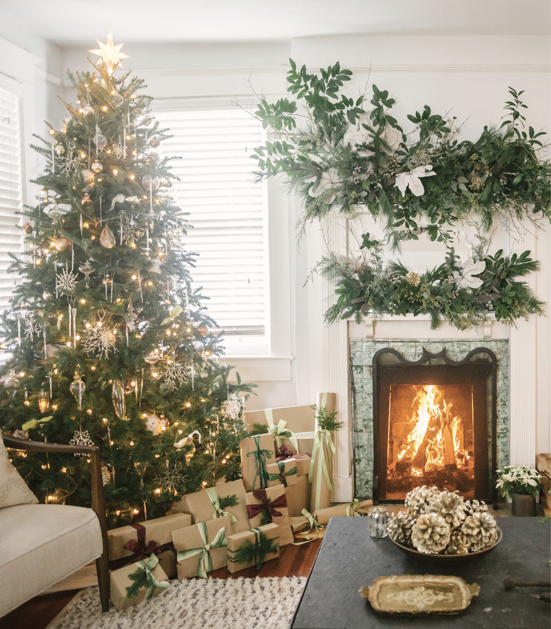 Classic holiday decor and woodsy flourishes in the living room of Heather's circa-1920s bungalow