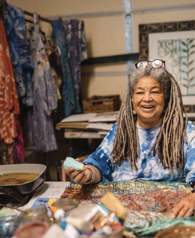 Textile artist Arianne King Comer in her garage work space.