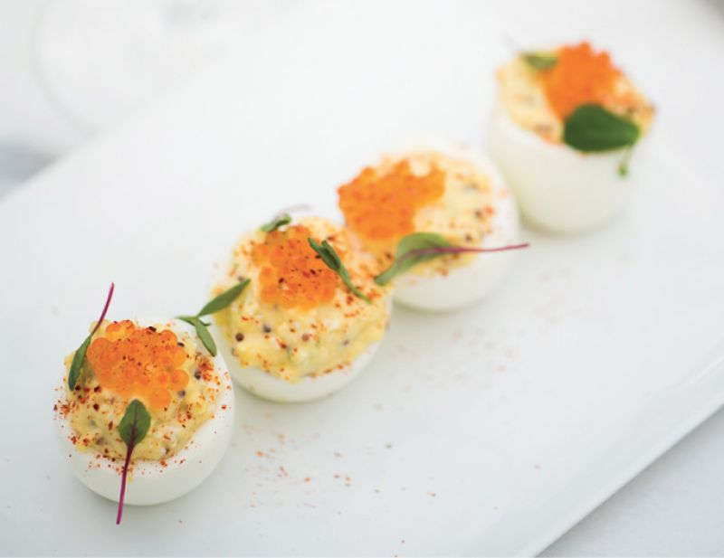 Eggs on eggs: Trout roe sits atop tangy deviled eggs, offered on both the lunch and dinner menus.