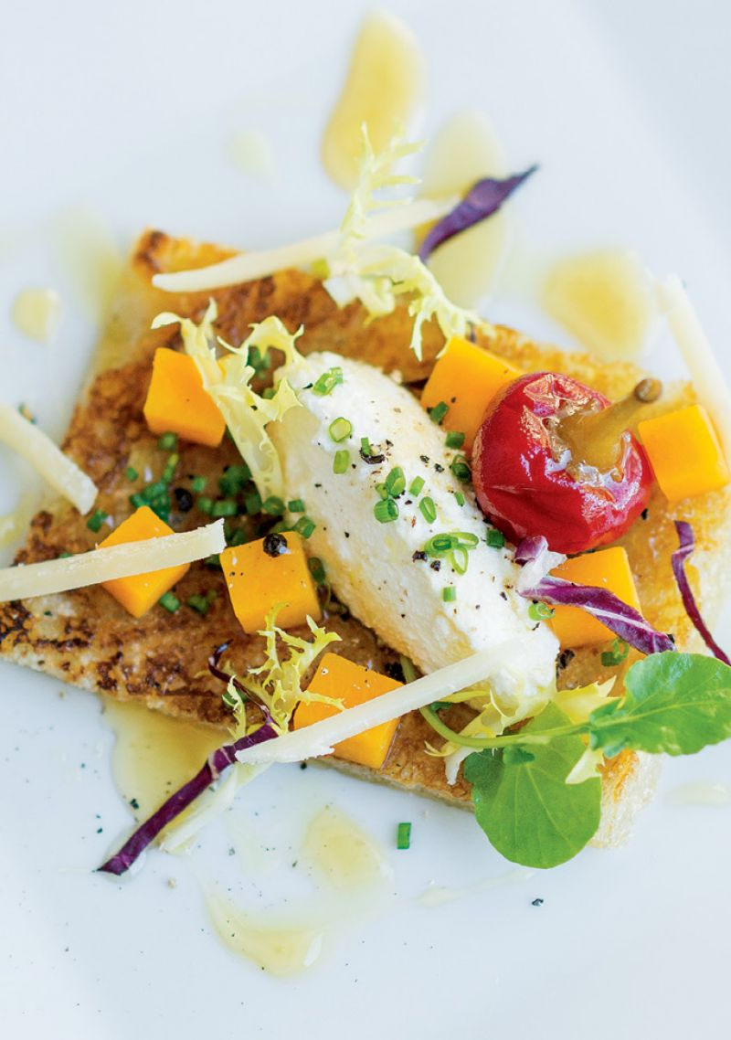 For Starters: Scattered greens, a pickled pepper, squash pieces, and shaved Pecorino add color and texture to Vedrinski's winter squash and sheep's milk ricotta bruschetta.