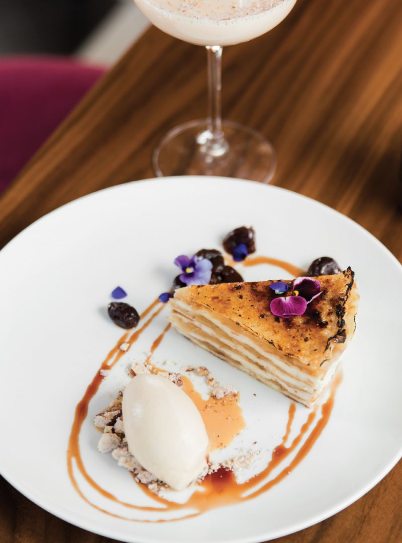 Layered beauty: Pastry chef Jenn McCoy's flower-adorned apple crêpe cake pairs well with bar manager Ryan Casey's White Elephant cocktail.