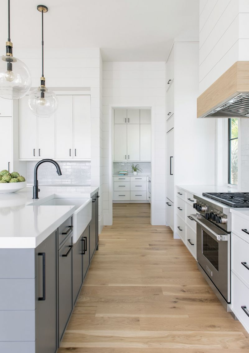 """""""Shiplapping the whole house was in line with coastal living, but we removed all decorative trim elements to create a minimal, unfussy vibe,"""" says Lenox."""