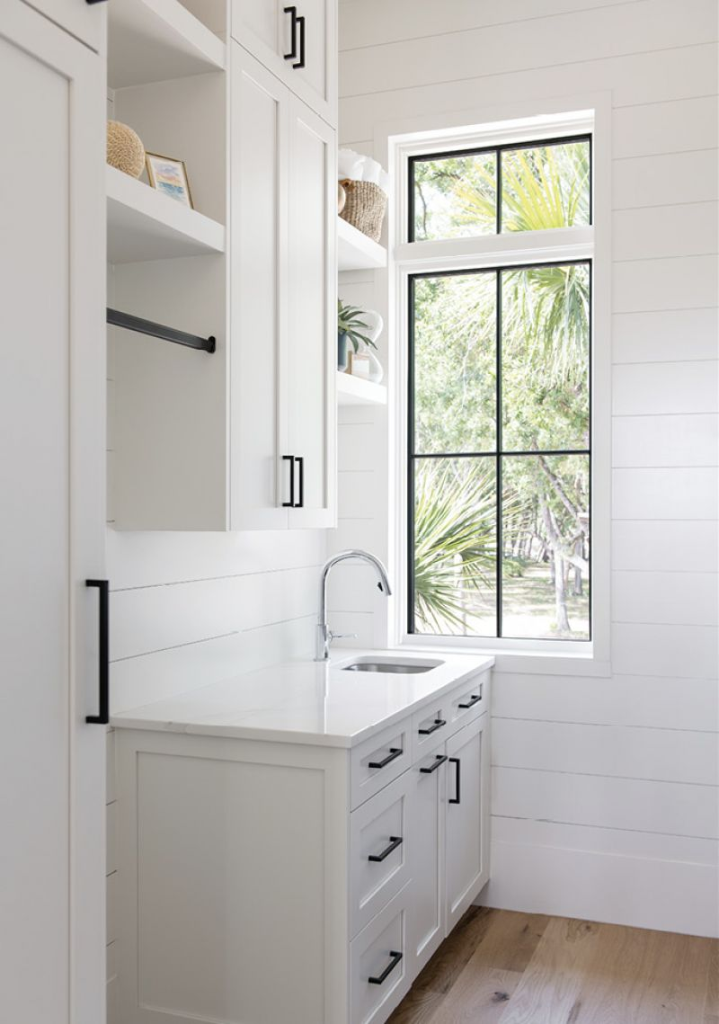 Ship to Shore: Modern, simplified shaker cabinets pair with shiplap on the island and walls to create a clean, simple look in the kitchen, pantry, and laundry room.