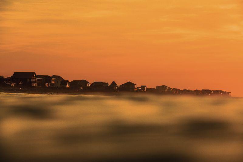 The bright orange glow of a summer sunrise near East 4th Street