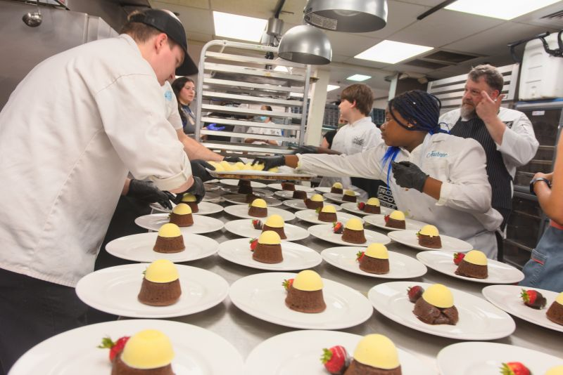 Chocolate lava cakes by Halls Signature Events chef Richard Plaistowe and little chef Trevin Lamber are plated for guests.