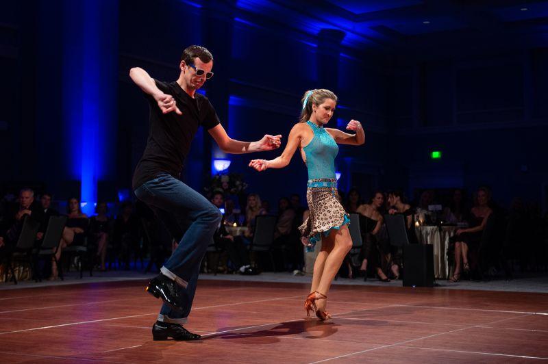 Professional dancer Maksym Sidak gets down on the dance floor with his partner Reagan Ferguson. 