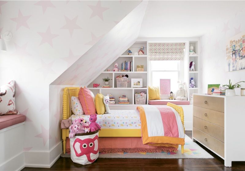 "HAPPY DAYS - The third floor houses Honor and Finn's rooms and their cheerful bath. ""I feel like we did a good job at giving these a magical feeling, a place for them to be little kids,"" says Parker. Playful wallpaper—Sissy+Marley's ""Lucky Star"" for her"