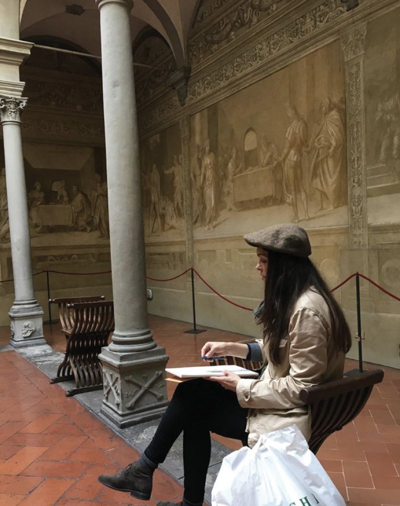 """I can go into a museum anywhere and feel immediately at home,"" says Hooper. The artist spends as much time as possible each year in London, with visits to Italy (pictured, in Florence at the Cloister of the Scalzo sketching a study of Del Sarto's frescoes)."