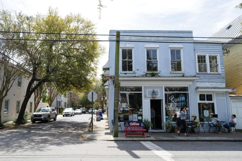 """Small, locally owned businesses like Queen Street Grocery, a revived former apothecary and circa-1922 corner grocery in Harleston Village, add neighborhood flavor and create walkable places for food and gatherings. Corner stores were historically a downtown mainstay, notes Kristopher King, """"but we occasionally get NIMBY pushback from residents wary of noise and traffic."""""""
