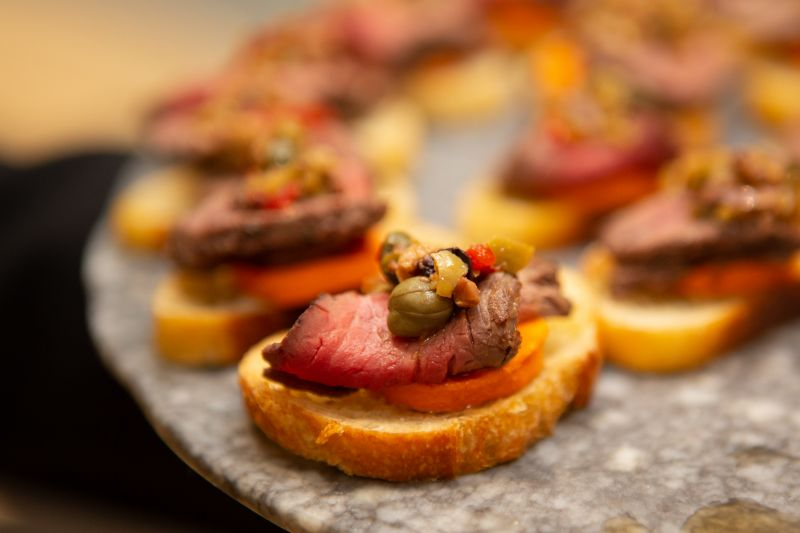 Filet mignon with peperchilies on a rostini were one of the many delectable hors d'oeuvres served on marble slabs.