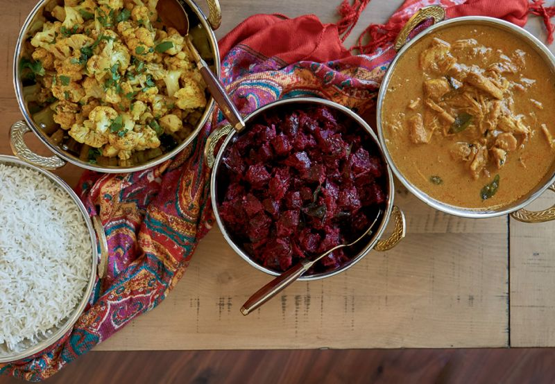 (From left to right) White rice forms a starchy base for spicy seasoned cauliflower, simmered beets, and hearty chicken curry.