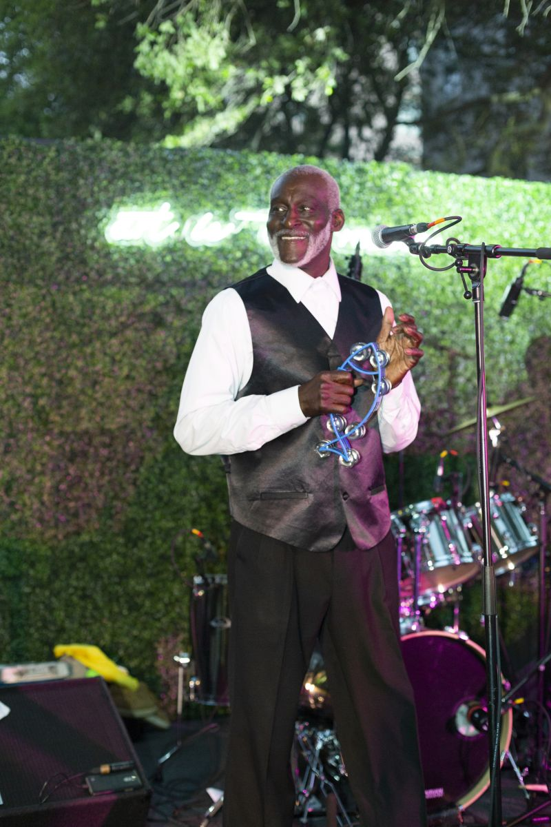 Upbeat tunes from The First Class Band set the tone for this vibrant celebration.