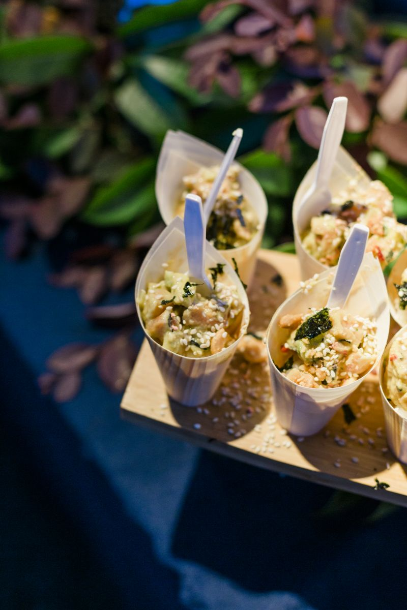 Paper cones filled with salmon poke, courtesy of Red Drum.