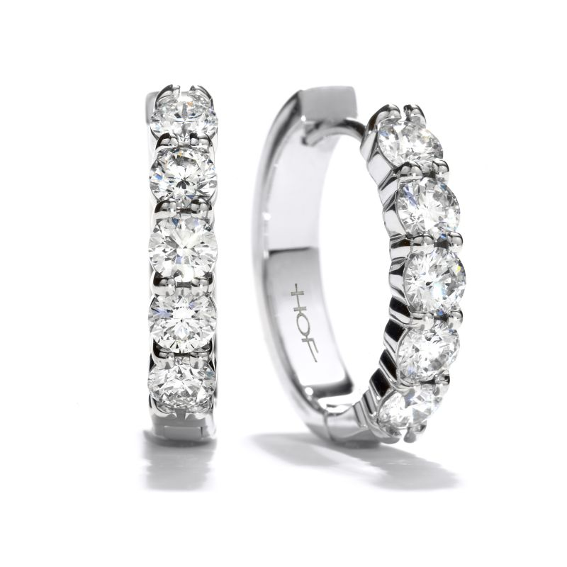 """Hearts on Fire 18K white-gold mini """"Huggie"""" diamond hoops, price upon request at Sandler's Diamonds & Time"""