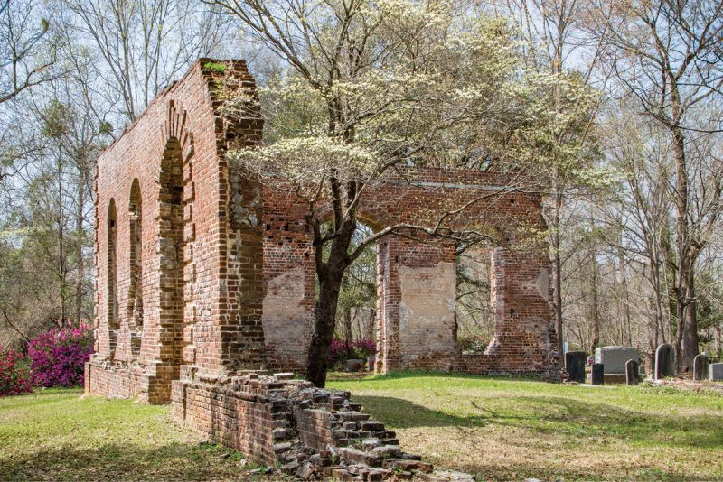 """The property near Moncks Corner was listed in the National Register of Historic Places in 1977: """"Notable architectural details which remain include a Gibbs surround at the main portal, quoins at the corner, radiating voussoirs over the windows, and a rounded water table."""""""