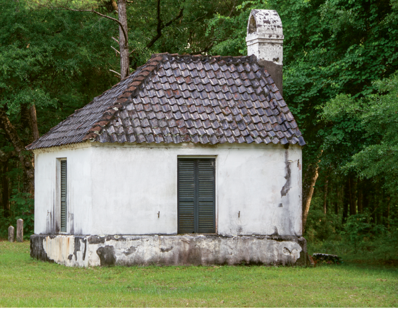 """St. Thomas: """"The unusual vestry building features a hipped roof on one end and chimney on the other, giving the appearance of a half-completed structure."""""""